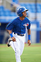 GCL Blue Jays shortstop Jesus Navarro (82) runs to first during the first game of a doubleheader against the GCL Phillies on August 15, 2016 at Florida Auto Exchange Stadium in Dunedin, Florida.  GCL Phillies defeated the GCL Blue Jays 7-5 in a continuation of a game originally started on July 30th.  (Mike Janes/Four Seam Images)