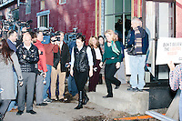 Heidi Cruz (in green), wife of Texas senator and Republican presidential candidate Ted Cruz, leaves the venue afer her husband spoke at a town hall at Crossing Life Church in Windham, New Hampshire, on Tues. Feb. 2, 2016. The day before, Cruz won the Iowa caucus.