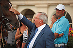 Trainer Shug McGaughey gives Data Link a celebratory pet after winning the Canadian Turf (G3T) at Gulfstream Park. Hallandale Beach Florida. 02-23-2013