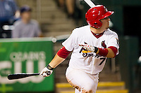 Zack Cox (7) of the Springfield Cardinals follows through his swing during a game against the Tulsa Drillers at Hammons Field on July 18, 2011 in Springfield, Missouri. Tulsa defeated Springfield 13-8. (David Welker / Four Seam Images)