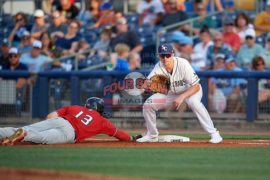 Charlotte Stone Crabs first baseman Russ Olive (34) catches a pickoff attempt throw as Ryan Costello (13) dives back to the bag during a Florida State League game against the Fort Myers Miracle on April 6, 2019 at Charlotte Sports Park in Port Charlotte, Florida.  Fort Myers defeated Charlotte 7-4.  (Mike Janes/Four Seam Images)