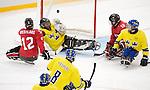 Greg Westlake and Billy Bridges, Sochi 2014 - Para Ice Hockey // Para-hockey sur glace.<br /> Team Canada takes on Sweden in Para Ice Hockey // Équipe Canada affronte la Suède en para-hockey sur glace. 08/03/2014.