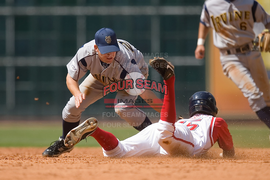 Second baseman Casey Stevenson #27 of the UC-Irvine Anteaters applies the tag to Zak Presley #15 of the Houston Cougars as he tries to steal second base in the 2009 Houston College Classic at Minute Maid Park February 28, 2009 in Houston, TX.  The Anteaters defeated the Cougars 13-7. (Photo by Brian Westerholt / Four Seam Images)