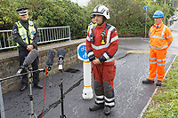 Pictured L-R: Superintendent Andy Moore of British Transport Police, Chief Inspector Chris Fraser of Dyfed Powys Police, Phil Kelly, Group Manager Richard Felton of Mid and West Wales Fire Service and root director for Network Rail Wales and Borders during a press conference near the scene of the train fire in Llangennech, Wales, UK. Thursday 27 August 2020<br /> Re: A freight train carrying diesel has derailed and burst into flames in Llangennech, near Llanelli, Wales, UK.<br /> People living nearby in Carmarthenshire, were evacuated but have since returned to their homes.<br /> Police declared a major incident, put a cordon in place and closed roads.<br /> The two workers who were on board the train have been accounted for and no injuries have been reported according  to the British Transport Police.