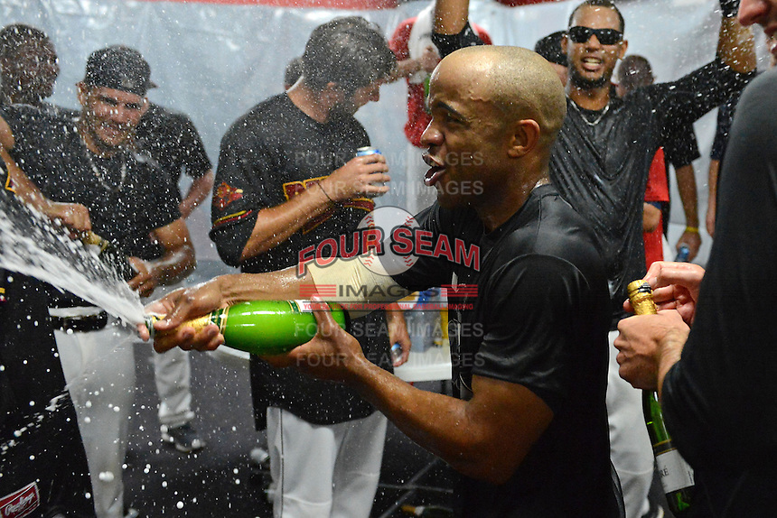 Rochester Red Wings outfielder Antoan Richardson celebrates in the locker room after defeating the Scranton Wilkes Barre RailRiders on September 2, 2013 at Frontier Field in Rochester, New York to clinch the International League Wild Card Playoff spot.  (Mike Janes/Four Seam Images)