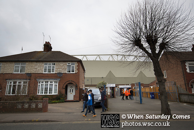 Peterborough United 1 Chesterfield 0, 21/03/2015. Abax Stadium, League One. Home supporters walking past the entrance to the Norwich and Peterborough stand at the Abax Stadium, before Peterborough United play Chesterfield in a SkyBet League One fixture. The home team won the match by one goal to nil, watched by a crowd of 6,612. The result allowed Peterborough to leapfrog their opponents into the League One play-off positions with eight games remaining of the season. Photo by Colin McPherson.