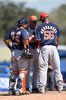 Houston Astros pitching coach Brent Strom (53 - center) talks with pitcher Roberto Hernandez (56) and catcher Hank Conger (16) during a Spring Training game against the Toronto Blue Jays on March 9, 2015 at Florida Auto Exchange Stadium in Dunedin, Florida.  Houston defeated Toronto 1-0.  (Mike Janes/Four Seam Images)