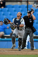 Tampa Yankees catcher Francisco Arcia looks for a pop up in front of umpire Fernando Rodriguez during a game against the Dunedin Blue Jays on April 11, 2013 at Florida Auto Exchange Stadium in Dunedin, Florida.  Dunedin defeated Tampa 3-2 in 11 innings.  (Mike Janes/Four Seam Images)