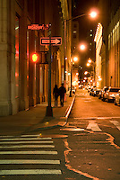 AVAILABLE FROM GETTY IMAGES FOR COMMERCIAL AND EDITORIAL LICENSING.  Please go to www.gettyimages.com and search for image # 174026324.<br /> <br /> Young Couple Walking at Night on an Empty Street in Lower Manhattan's Financial District, New York City, New York State, USA