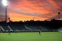 CARY, NC - AUGUST 01: Orange and red sunset over the stadium during a game between Birmingham Legion FC and North Carolina FC at Sahlen's Stadium at WakeMed Soccer Park on August 01, 2020 in Cary, North Carolina.