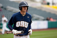 Brandon Healy (14) of the Oral Roberts Golden Eagles heads back to the dugout after batting during a game against the Missouri State Bears on March 27, 2011 at Hammons Field in Springfield, Missouri.  Photo By David Welker/Four Seam Images