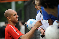 Goalkeeper Tim Howard signs autographs during the U. S. men's national team practice at Princeton University in Princeton, NJ, on May 22, 2010.
