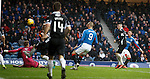 Michael O'Halloran loops in the second goal for Rangers above keeper Robbie Thomson