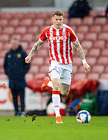 20th February 2021; Bet365 Stadium, Stoke, Staffordshire, England; English Football League Championship Football, Stoke City versus Luton Town; James McClean of Stoke City chases a loose ball