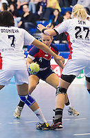 22 OCT 2011 - LONDON, GBR - Britain's Nina Heglund (#05 / in blue and red) tries to find her way past Russia's Liudmila Bodnieva (#07 - white) and Anna Sen (#27 - white) during the Women's 2012 European Handball Championship qualification match between the two teams at the National Sports Centre at Crystal Palace.(PHOTO (C) NIGEL FARROW)