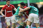 Wales scrum half Mike Phillips runs into trouble as Mike Ross and Sean O'Brien close the gap..RBS 6 Nations.Wales v Ireland.Millennium Stadium.02.02.13.©Steve Pope-SPORTINGWALES