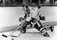 Up and Over: Montreal's Yvan Cournoyer falls over Leaf Randy Carlyle during Canadiens' 3-2 win over Leafs last night at Forum. Habs grabbed quick 2-0 lead and then held off Leafs attempt at comeback. Montreal coach Scotty Bowman says Habs got over major hurdle by beating hopped-up Leafs twice at home. We played some of our best hockey, he said<br /> <br /> Bezant, Graham<br /> Picture, 1978<br /> <br /> 1978<br /> <br /> PHOTO : Graham Bezant - Toronto Star Archives - AQP