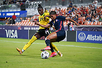 HOUSTON, TX - JUNE 13: Margaret Purce #20 of the United States battles with Deneisha Blackwood #14 of Jamaica during a game between Jamaica and USWNT at BBVA Stadium on June 13, 2021 in Houston, Texas.