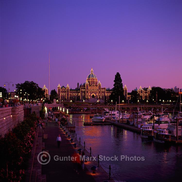 Victoria, BC, Vancouver Island, British Columbia, Canada - BC Parliament Buildings illuminated at Dusk along Inner Harbour