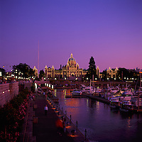 Victoria, BC, Vancouver Island, British Columbia, Canada - BC Parliament Buildings illuminated at Dusk along Inner Harbour