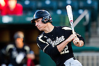 Cameron Perkins (22) of the Purdue Boilermakers follows through his swing during a game against the Missouri State Bears at Hammons Field on March 13, 2012 in Springfield, Missouri. (David Welker / Four Seam Images)