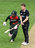 20th March 2021; Dunedin, New Zealand;  Mahmudullah runs around Jimmy Neesham during the New Zealand Black Caps v Bangladesh International one day cricket match. University Oval, Dunedin.