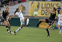 Marta (center) and Leigh Ann Robinson (7) jump for the ball. LA Sol and FC Gold Pride tied 0-0 at Buck Shaw Stadium in Santa Clara, California on July 23, 2009.