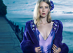 Beauty portrait of a young beautiful blond woman wearing a blue evening dress and a fur jacket outdoors at waterfront Image © MaximImages, License at https://www.maximimages.com