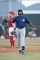 Demi Orimoloye (18) of the AZL Brewers reacts in pain after being hit in the hand by a pitch during a game against the AZL Reds at the Cincinnati Reds Spring Training Complex on July 5, 2015 in Goodyear, Arizona. Reds defeated Brewers, 9-4. (Larry Goren/Four Seam Images)