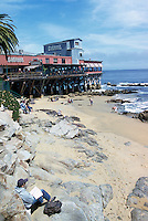 "Beach and Restaurant along Monterey Bay at Steinbeck Plaza, along ""Cannery Row"", in the City of Monterey, California, USA"