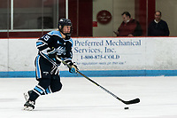 BOSTON, MA - JANUARY 04: Ida Press #15 of University of Maine brings the puck forward during a game between University of Maine and Boston University at Walter Brown Arena on January 04, 2020 in Boston, Massachusetts.