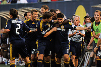 Alecko Eskandarian (11) of the Los Angeles Galaxy celebrates scoring with teammates including David Beckham (23). The Los Angeles Galaxy defeated the New York Red Bulls 3-1 during a Major League Soccer match at Giants Stadium in East Rutherford, NJ, on July 16, 2009.