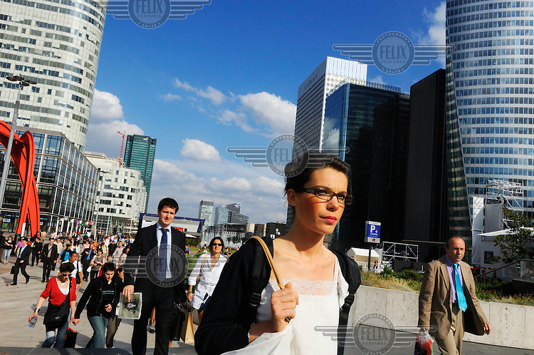 Office workers going home at La Defence, the city's financial centre, and headquarters to many of France's largest companies.