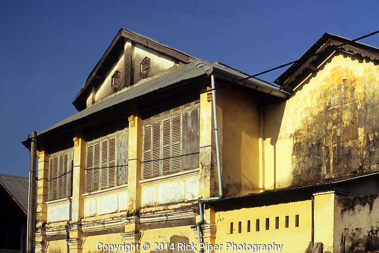 Kampot Old Colonial 01<br /> Weathered decaying wooden shuttered facade of old French colonial building in the centre of Kampot, Cambodia, by Rick Piper Photography