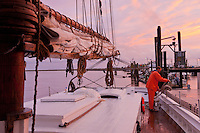 Deck Hand on the Historic Tall Ship, A.J. Meerwald, at sunset, Bivalve, New Jersey