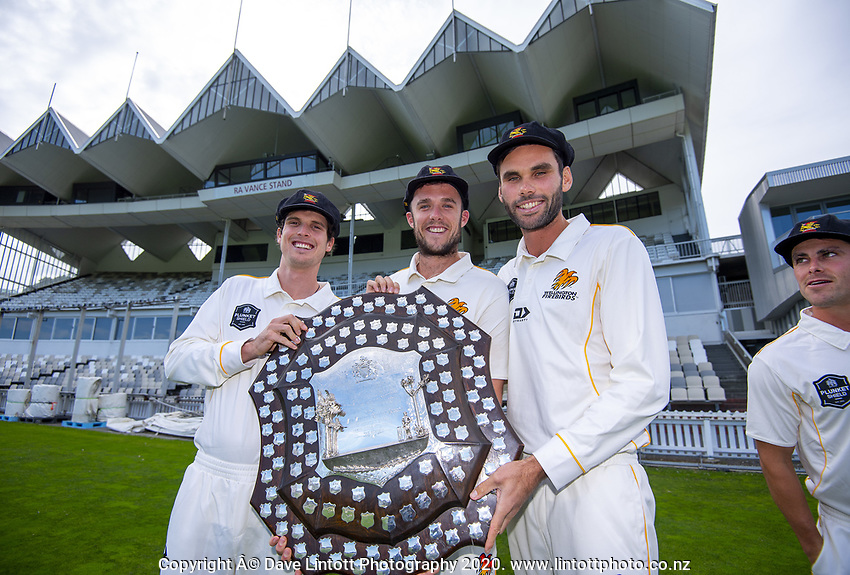 From left, Andrew Fletcher, Jamie Gibson, Michael Snedden and Peter Younghusband. The Wellington Firebirds celebrate winning the 2019-2020 Plunket Shield at Basin Reserve in Wellington, New Zealand on Thursday, 19 March 2020. Photo: Dave Lintott / lintottphoto.co.nz
