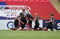 Callum Morton (on loan from WBA) of Northampton Town celebrates with team mates after he scores his team's second goal during the Sky Bet League 2 PLAY-OFF Final match between Exeter City and Northampton Town at Wembley Stadium, London, England on 29 June 2020. Photo by Andy Rowland.