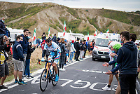On the very day his country is thrown back into a war with Armenia, Azerbajan Elchin Asadov (AZE) is cheered up the Cima Gallisterna Climb (2.3km @ 7%) as the last rider in the race (at that point).<br /> <br /> Men's Elite Road Race from Imola to Imola (258km)<br /> <br /> 87th UCI Road World Championships 2020 - ITT (WC)<br /> <br /> ©kramon