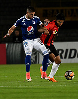 BOGOTA - COLOMBIA – 17 - 04 - 2018: Matias de los Santos (Izq.) jugador de Millonarios (COL), disputan el balon con Jesus Hernandez (Der.) jugador de Deportivo Lara (VEN), durante partido entre Millonarios (COL) y Deportivo Lara (VEN), de la fase de grupos, grupo G, fecha 3 de la Copa Conmebol Libertadores 2018, en el estadio Nemesio Camacho El Campin, de la ciudad de Bogota. / Matias de los Santos (L) player of Millonarios (COL), fights for the ball with Jesus Hernandez (R) player of Deportivo Lara (VEN), during a match between Millonarios (COL) and Deportivo Lara (VEN), of the group stage, group G, 3rd date for the Conmebol Copa Libertadores 2018 in the Nemesio Camacho El Campin stadium in Bogota city. VizzorImage / Luis Ramirez / Staff.