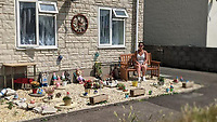 BNPS.co.uk (01202 558833)<br /> Pic: EmmaCollins/BNPS<br /> <br /> Pictured: Emma Collins in the memorial garden. <br /> <br /> A grieving mother has been ordered by officials to remove a memorial garden she built for her son who died on his 16th birthday. <br /> <br /> Emma Collins made the garden on a small patch of land right outside her ground floor flat.<br /> <br /> It became a source of comfort for the heartbroken mother whose son, Daniel, died in a quad biking accident.<br /> <br /> However she has received a phone call from Aster Group, the housing association which owns the block of flats in Portland, Dorset, telling her the memorial was obstructive.