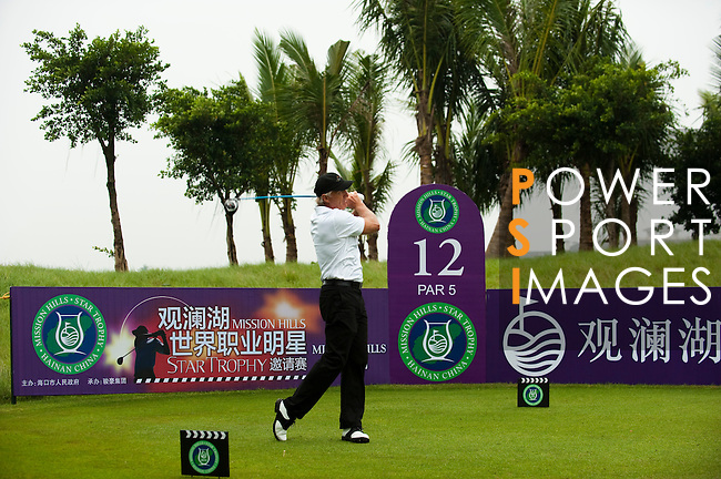 HAIKOU, CHINA - OCTOBER 27:  Golf legend Greg Norman teaches practicing ahead of the inaugural Mission Hills Star Trophy on October 27, 2010 in Haikou, China.  The Mission Hills Star Trophy is Asia's leading leisure liflestyle event and features Hollywood celebrities and international golf stars. Photo by Victor Fraile / The Power of Sport Images