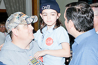 Christian and daughter Fiona Furze, 8, of Nashua, NH, meet and pose for pictures with Texas senator and Republican presidential candidate Ted Cruz after he spoke at a town hall at The Alpine Grove banquet center in Hollis, New Hampshire. Christian Furze says he is a Cruz supporter.