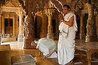 JAIN DEVOTEES do their prayers inside a JAIN TEMPLE in the JAISALMER FORT - RAJASTHAN, INDIA.