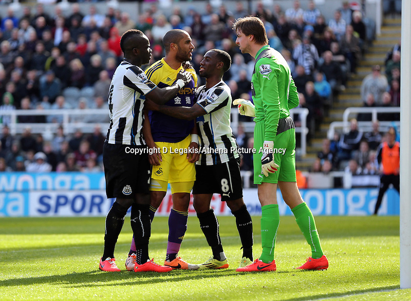 Pictured: Ashley Williams of Swansea (2nd L_ is held back by Cheik Tiote (L) and Vernon Anita (3rd L) of Newcastle as the former tries to square up against goalkeeper Tim Krul. Saturday 19 April 2014<br /> Re: Barclay's Premier League, Newcastle United v Swansea City FC at St James Park, Newcastle, UK.