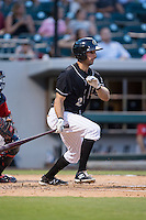 Drew Garcia (2) of the Charlotte Knights follows through on his swing against the Gwinnett Braves at BB&T BallPark on August 11, 2015 in Charlotte, North Carolina.  The Knights defeated the Braves 3-2.  (Brian Westerholt/Four Seam Images)