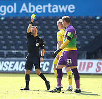 17th April 2021; Liberty Stadium, Swansea, Glamorgan, Wales; English Football League Championship Football, Swansea City versus Wycombe Wanderers; David Stockdale of Wycombe Wanderers is shown a yellow card by Referee Keith Stroud for kicking the ball away after the penalty kick
