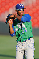 Right fielder Elier Hernandez (12) of the Lexington Legends warms up before a game against the Greenville Drive on Friday, August 29, 2014, at Fluor Field at the West End in Greenville, South Carolina. Hernandez is the No. 11 prospect of the KansasCity Royals, according to Baseball America. Greenville won, 6-1. (Tom Priddy/Four Seam Images)