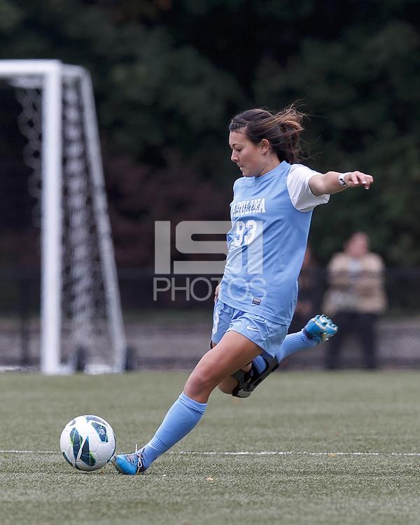 University of North Carolina midfielder Brooke Elby (93) passes the ball.   University of North Carolina (blue) defeated Boston College (white), 1-0, at Newton Campus Field, on October 13, 2013.