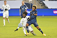 KANSAS CITY, KS - OCTOBER 24: Lalas Abubakar #6 Colorado Rapids and <br /> Gianluca Busio #27 of Sporting Kansas City challenge for the ball during a game between  at Children's Mercy Park on October 24, 2020 in Kansas City, Kansas.
