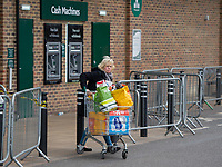 A shopper leaving Morrisons during the Coronavirus pandemic at Sidcup, Kent, England on 2 April 2020. Photo by Alan Stanford.